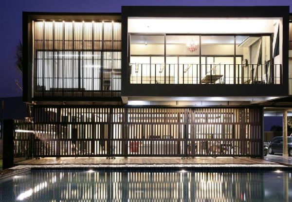 front-view-in-ubon-house-modern-tropical-house-with-large-swimming-pool